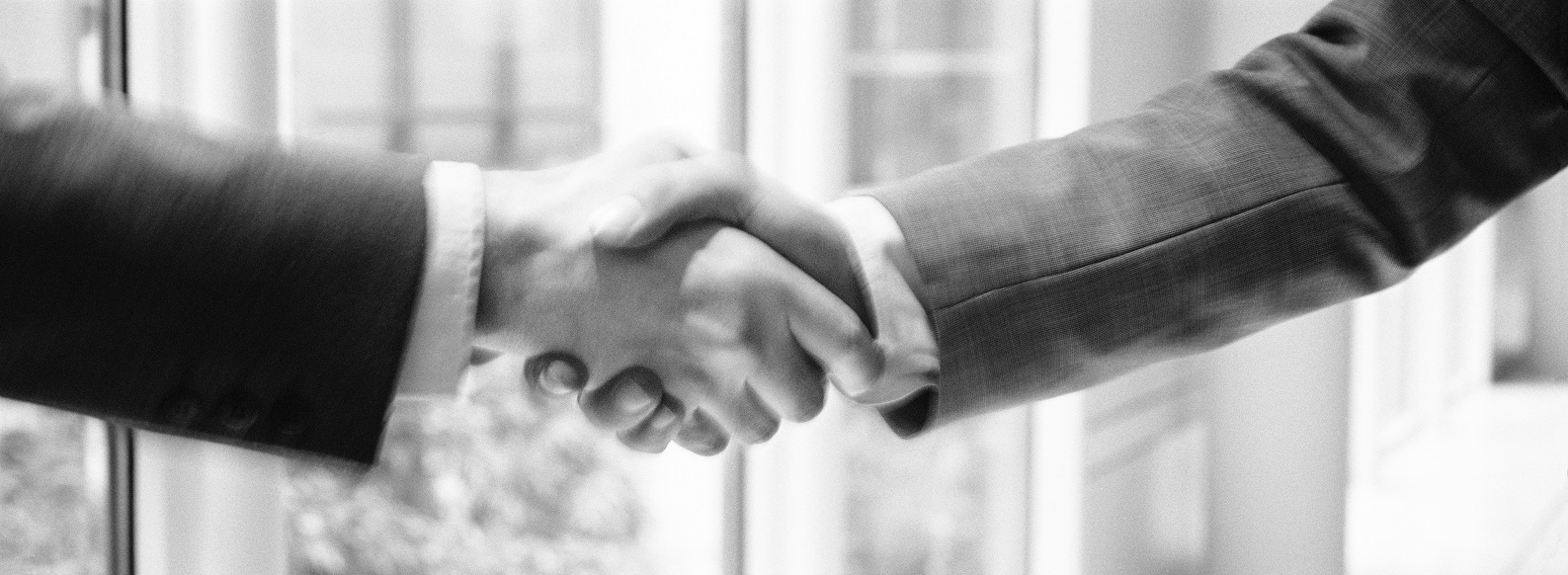 Two man hands in handshake, B&W